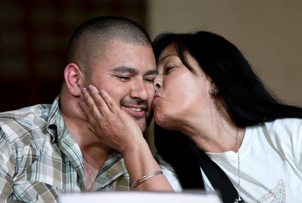 Guadalupe Melendez kisses her son Israel Arzate during a news conference in Mexico City last week after he was freed by the Mexican Supreme Court. Arzate says soldiers tortured him into confessing to a role in a 2010 massacre.