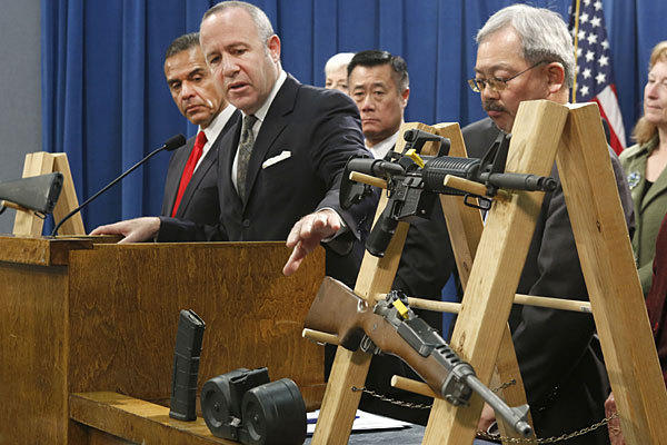 Senate leader Darrell Steinberg, second from left, sponsored a bill, vetoed by Gov. Jerry Brown, that would have banned sales of most semiautomatic rifles that accept detachable magazines.