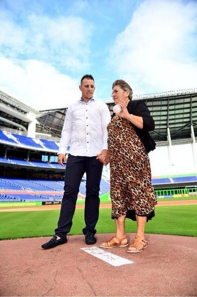 Jose Fernandez gives his maternal grandmother, Olga, a tour of his office -- the field at Marlins Park.