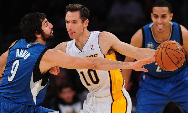 Lakers guard Steve Nash tries to dribble past Minnesota Timberwolves guard Ricky Rubio during a game at Staples Center.
