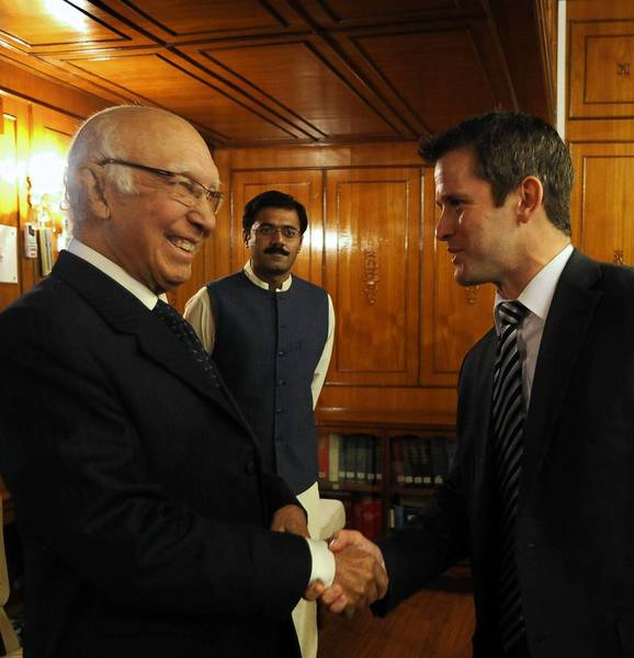 Illinois Rep. Adam Kinzinger, right, meets Sartaj Aziz, an adviser on foreign affairs, this month in Islamabad