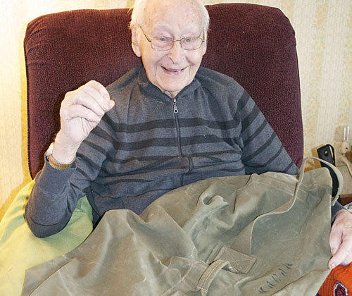William Kadar in January with the duffel bag he had left behind in France nearly 70 years earlier.