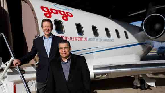 Gogo executives Michael Small and CMO Ash El Difrawi prepare to demonstrate the in-flight Wi-Fi provider's technology at the Aurora Municipal Airport in 2012.