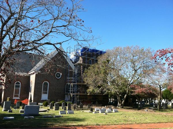 Scaffolding surrounds a portion of St. John's Episcopal Church in downtown Hampton.