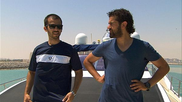 Cousins Leo (left) and Jamal (right) travel by yacht to the Yas Marina in search of the next clue.