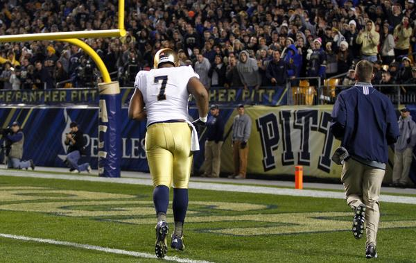 Stephon Tuitt of the Notre Dame Fighting Irish runs off the field after being ejected after a helmet to helmet hit against the Pittsburgh Panthers on Saturday.