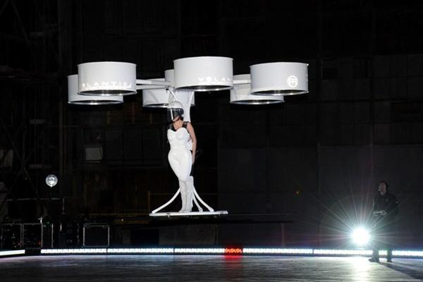 Lady Gaga landing at her ArtRAVE album party in Brooklyn, N.Y. Sunday night wearing the first copter-dress.