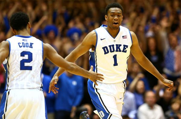 Chicago native and Duke player Jabari Parker (right) celebrates with teammate Quinn Cook after a dunk against Davidson on Nov. 8.