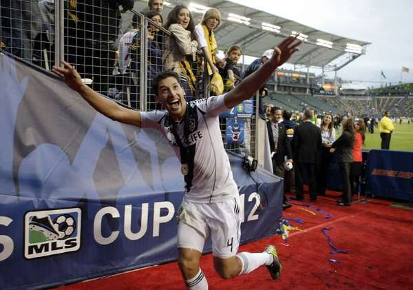 Galaxy defender Omar Gonzalez reacts to fans during a game.