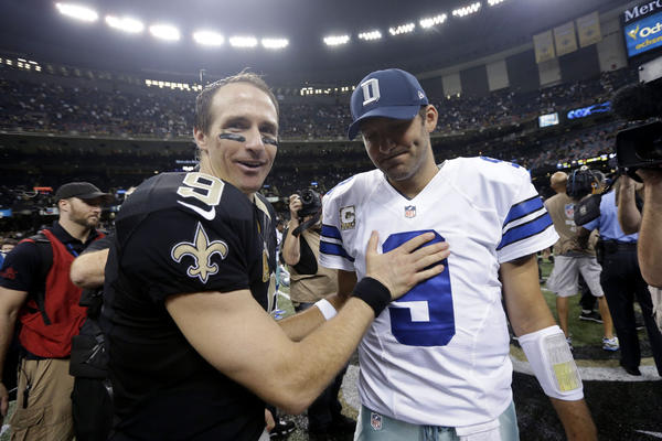New Orleans Saints quarterback Drew Brees greets Dallas Cowboys quarterback Tony Romo after their game.