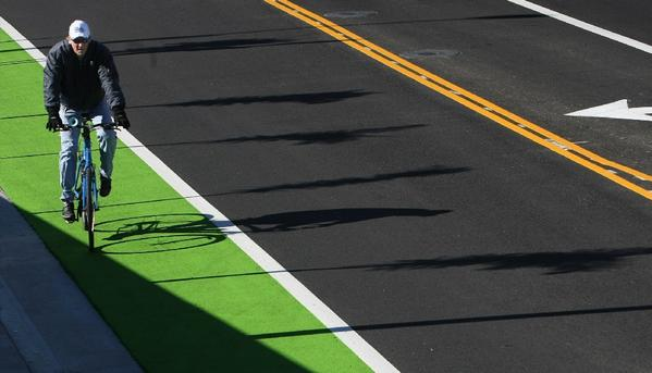 A cyclist makes his way along Ocean Boulevard in Santa Monica.