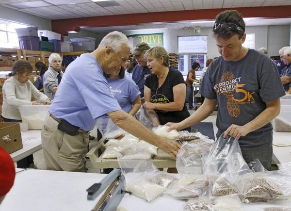 About 50 volunteers bagged 2,000 pounds of beans and rice in one-pound bags at Salvation Army Glendale on Saturday.Volunteers from the Salvation Army, Glendale Kiwanis and Glendale College Circle K lent a hand to bag food that will go out to about 1,000 families.