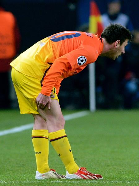 (FILES) A file picture taken on April 2, 2013 shows Barcelona's Argentinian forward Lionel Messi holding his leg during the Champions League quarter-final football match between Paris Saint-Germain and Barcelona at the Parc des Princes stadium in Paris. Barcelona's Argentinian star Lionel Messi will be sidelined for 6-8 weeks due to a muscle tear in his left hamstring muscle, the Spanish giants said on November 11, 2013. The four-time World Player of the Year limped off after just 20 minutes of Barcelona's 4-1 win over Real Betis on November 10, the third time this season that he has been forced off with a muscular problem.