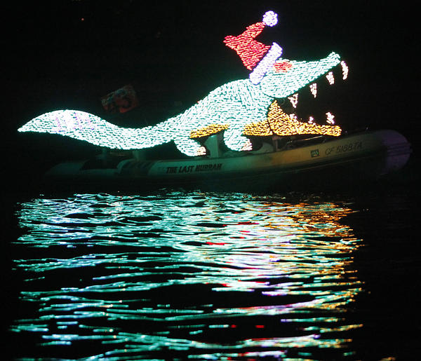 A crocodile flows behind The Last Hurrah, by J. Roberts and Elizabeth Meadows, during the 103rd annual Newport Beach Christmas Boat Parade in 2011.