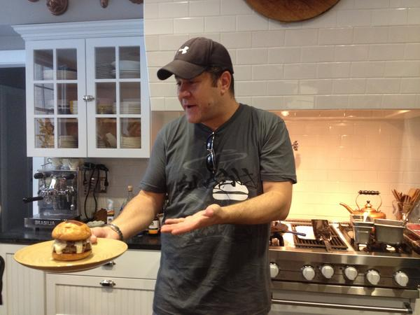 Adam Fleischman, founder of Umami Burger, hosts a burger-making demo at his Los Angeles home for members of social club Truffl.