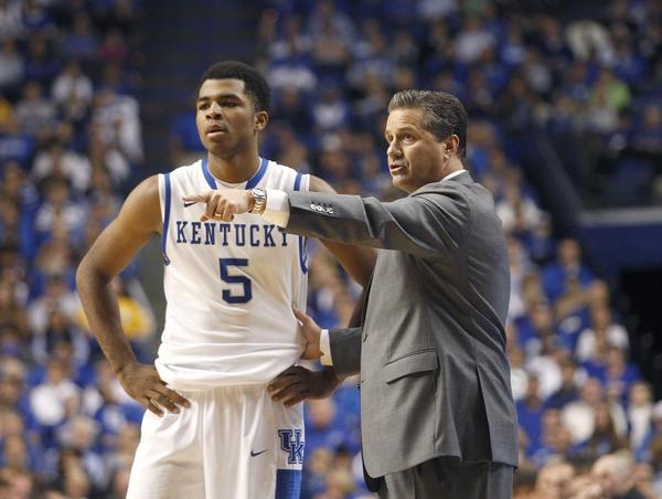 Head coach John Calipari of Kentucky has a teaching moment with Andrew Harrison during the second half against Northern Kentucky at Rupp Arena.