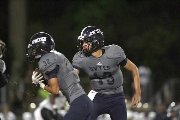 Dwyer quarterback Daniel Parr hands off to Steven Valazquez. The Panthers finished the regular season 10-0 and host Boyd Anderson (2-8) Friday in the regional quarterfinals. Photo/Jon Way