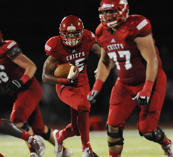 Cardinal Gibbons running back Deon McIntosh ran 18 times for 130 yards and three touchdowns in a 28-18 victory over Coral Springs. Staff photo/Jim Rassol