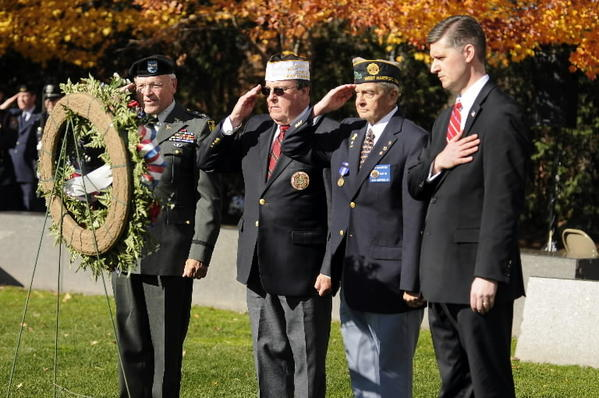 Veterans Dr. Rolf Knoll, John Eselunas, and Ken Hungerford and West Hartford Mayor Scott Slifka (l-r) salute after placing a wreath at the Veterans Memorial in West Hartford during Veterans Day ceremonies Monday.