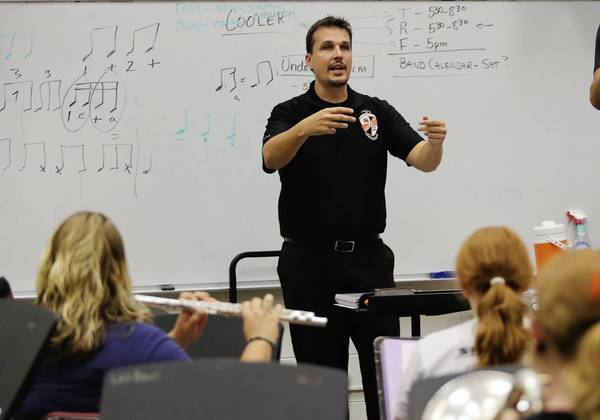 Gabriel Fielder, band director at Leesburg High, directs students on Friday, August 23, 2013. Fielder recently was selected to be a member of the American School Band Directors' Association.