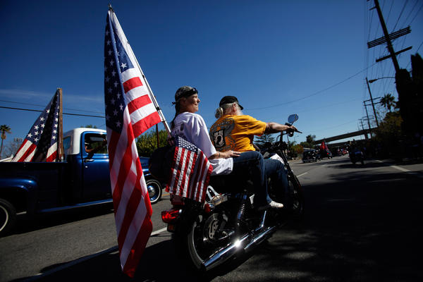 The Pow-MIA Riders, a motorcycle cub made up of veterans, drive along Laurel Canyon Blvd. during the San Fernando Valley Veterans Day Parade.