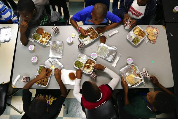 At the NFL YET Lester H. White Club, children have supper during a Boys & Girls Clubs program that serves supper to low-income children, part of their efforts to help the children perform better in school and succeed.