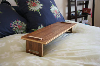 The tray is shown here in walnut plywood but is available in ash or cherry finishes too, all $100.