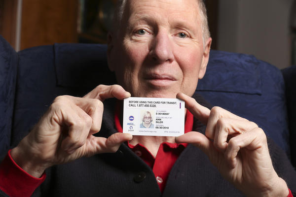 Stetson Siler, holding the Ventra card that his deceased mother received from the CTA, in his Oak Park home.