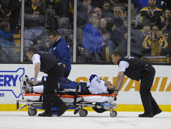 Tampa Bay Lightning center Steven Stamkos is wheeled off on a stretcher during the second period against the Boston Bruins at TD Banknorth Garden.