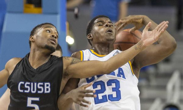 UCLA's Tony Parker, right, battles Cal State San Bernardino's Donte Medder for a loose ball during a preseason game last month. The Bruins will look to improve to 2-0 on the season Tuesday when they play Oakland.