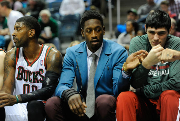 Nov 9, 2013; Milwaukee, WI, USA; Milwaukee Bucks center Larry Sanders (center) sits on the bench with guard O.J. Mayo (left) and forward Ersan Ilyasova (right) in the 2nd quarter at BMO Harris Bradley Center. Sanders did not play after suffering a hand injury in an off-court incident. Mandatory Credit: Benny Sieu-USA TODAY Sports ORG XMIT: USATSI-139660