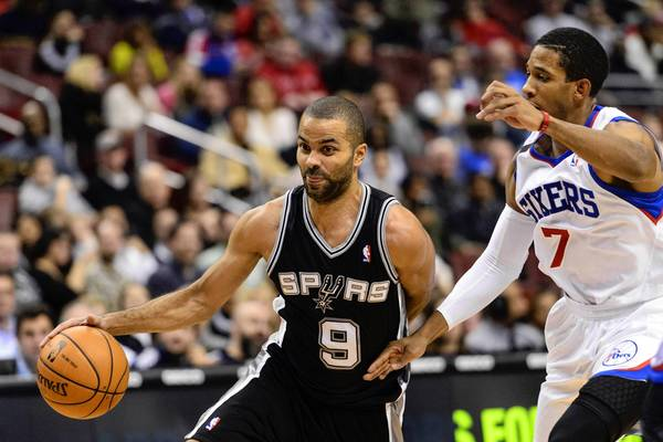 San Antonio Spurs guard Tony Parker (9) is defended by Philadelphia 76ers guard Darius Morris.
