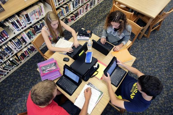 Studios, tech companies and music labels are financing the development of a grade-school curriculum to fight online piracy. Above, students in North Dakota work on their computers.