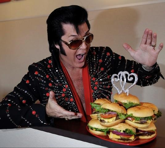 "Elvis, really Brendan Paul from Graceland Chapel, officiated Tuesday at the Smashburger wedding in Las Vegas. The hamburgers formed a wedding ""cake."""