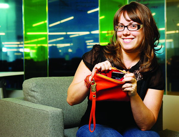 Liz Salcedo and her invention, a purse that charges a phone on the go.