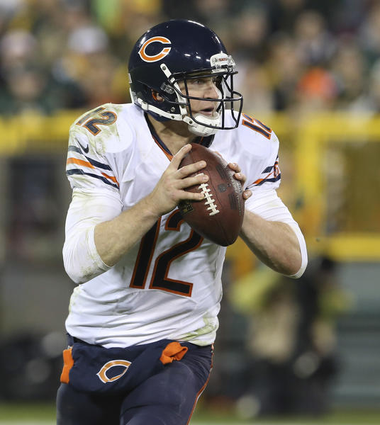 Bears quarterback Josh McCown looks to pass against the Packers.