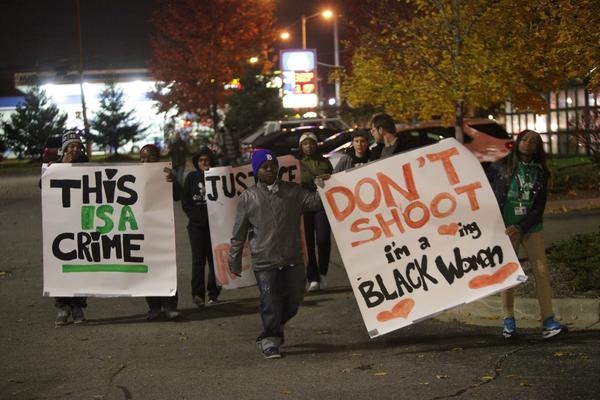 Protesters this month held signs during a rally in Dearborn Heights, Mich., to protest the shooting death of Renisha McBride.