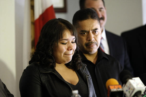 Gabriela Sanchez and Juan Arevalo, daughter and brother of slain store clerk Martha Sanchez, speak at a news conference to announce the filing of murder charges.