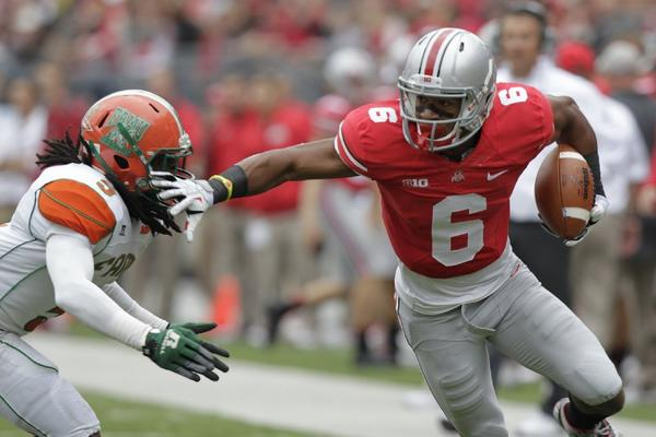 Ohio State wide receiver Evan Spencer avoids a Florida A&M defender during a game Sept. 21.