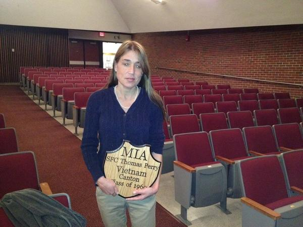 Fiona Perry with a plaque made by students at Canton High School honoring her uncle, who was declared missing in action in Vietnam. She was given the plaque during a Veterans Day ceremony at Canton High School on Tuesday.