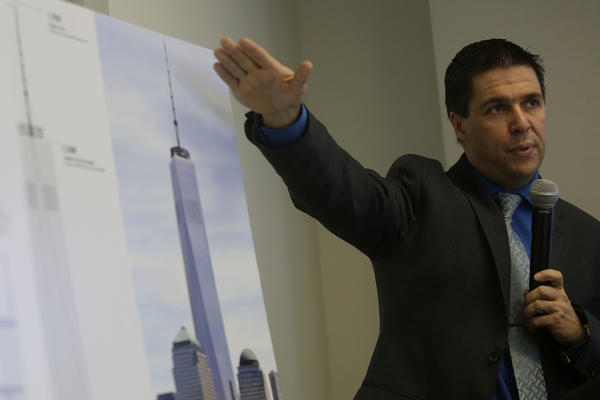 Council on Tall Buildings and Urban Habitat executive director Antony Wood discusses the differences between an antennae and a design element during a press conference at the Illinois Institute of Technology after announcing that New York City's One World Trade Center building will be the tallest building in the United States upon completion and occupancy.
