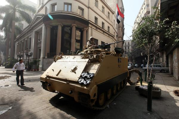 An Egyptian army armored vehicle is stationed in front of the Egyptian stock exchange in Cairo on Tuesday in advance of planned protests by supporters of ousted President Mohamed Morsi's Muslim Brotherhood. The government lifted a state of emergency that has been in place since Aug. 14.