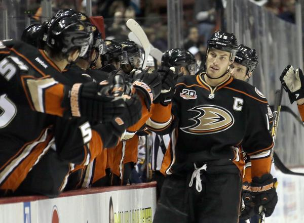 Ducks center Ryan Getzlaf is congratulated by teammates after the first of his three goals against Buffalo on Friday.