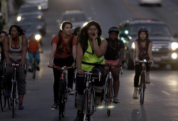Evelyn Martinez, front, shouts instructions as she and other female riders -- including members of the all-women bike crew Ovarian Psycos -- ride through Boyle Heights.