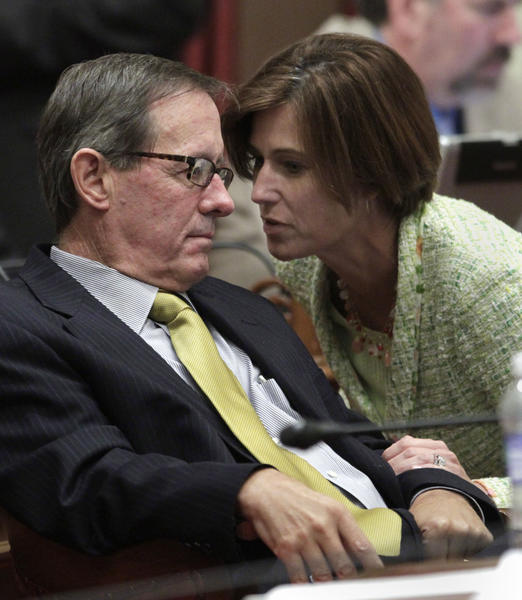 Republican state Sens. Tom Berryhill (R-Modesto) and Mimi Walters (R-Lake Forest)confer during a recent floor debate on the budget. Berryhill faces administrative charges of laundering campaign contributions to his brother.