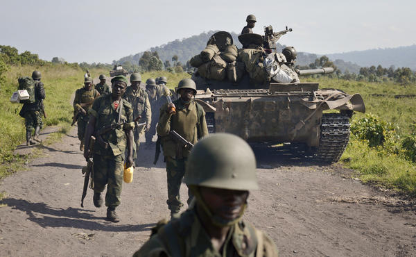 Last month, Congolese army soldiers march past a tank aimed toward Kibumba Hill, which was occupied by M23 rebels, near the provincial capital of Goma in the eastern Democratic Republic of Congo.
