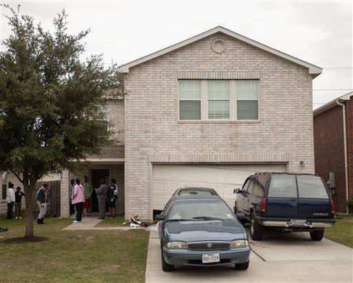 The Cypress, Texas, home where shooting erupted during a birthday party, leaving two dead and 19 hurt. Two young men were arrested, but charges against one have been dropped.