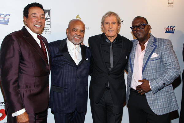 Smokey Robinson, left, Berry Gordy Jr., Michael Bolton and Randy Jackson arrive at the Grammy Museum gala tribute concert on Nov. 11, 2013, in Los Angeles.