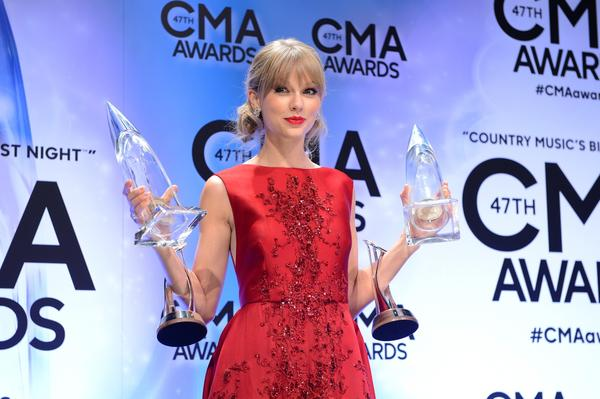 Pinnacle Award winner Taylor Swift poses at the CMA Awards.
