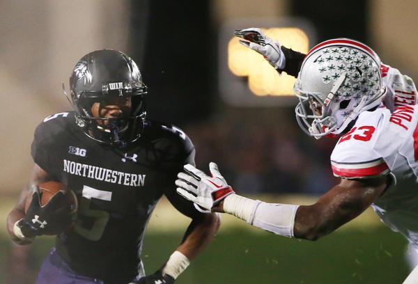 Northwestern running back Venric Mark runs against Ohio State on Oct. 5.